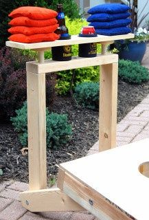 CornHole Game with cool built-in stand. A-mazing! Sarina you totally need these for your corn hole boards.