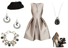 Silver dress paired with silver and black accessories.