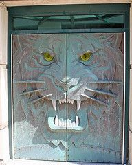 Bronze doors with a tiger's face.