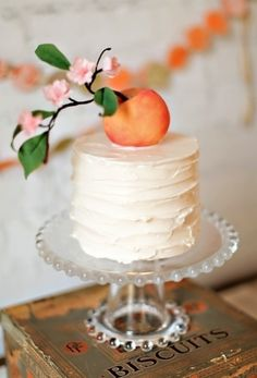 Wedding Cakes: Adorable #peach #cake topper. | Photo by: Jen Huang on Society Bride via Lover.ly