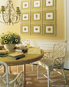 perfect for the living room, pulls colors from sofa and rug. blk frames, rust-colored matting, fam photos