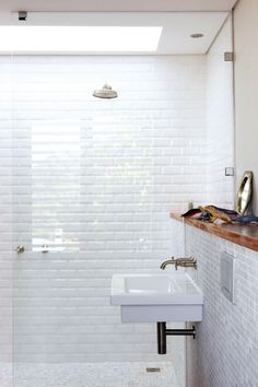 I think subway tiles will be too big. Smaller tiles may make the shower look bigger