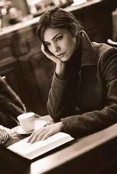 Pretty brunette with coffee and a book