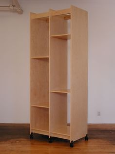 """Painting Storage Rack for storing art. This Art Storage System is is 38.25"""" wide x 99"""" tall x 23.75"""" deep. There are two 18"""" wide vertical spaces for storing paintings."""