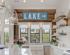 Bring a little fixer upper flair into your home with this vintage-look canvas LAKE sign for your home or kitchen - did someone say #shiplap? Comes in two sizes in your choice of background colors. How to Order: 1. Choose Size and Arrow Direction 2. Choose Colors: Colors shown in listing photos are white background with black letters, black background with white letters, and seaglass background with white letters.  FOR MORE FIXER UPPER SIGNS: https://www.etsy.com/shop/laure...