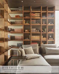 Librero en madera de parota   #CalidadDistrito85 #Interiorismo #DiseñoInterior  #gdl #madera #home #furniture #mueble #decoración #carpintería #wood #telas #texturas by distrito85