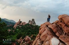 LOVE! Spectacular view on the top of the red rocks mountains of Colorado.  Super cute engagement session.  Best engagement photos and photography Top 5 Photo Location Ideas At Garden of The Gods Photography by Katie Corinne Photography