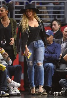 Casual chic: beyonce sported a black leather jacket draped over her shoulders over a match...