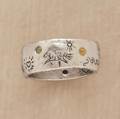 symbols of life ring  Glittering sapphires surround Jes MaHarry's symbols of a good life—a butterfly for grace, a horse for freedom—on a 14kt white gold band $ 4, 200