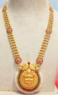 Beautiful gold long haaram with lakshmi devi pendant. Long haaram chain with triple layer ball chain. Long haaram studded with multi color precious stones. Kids Gold Jewellery, Gold Jewelry Simple, Gold Jewellery Design, Gold Earrings Designs, Necklace Designs, Gold Set, Jewelry Patterns, Pendant Jewelry, Bridal Jewelry
