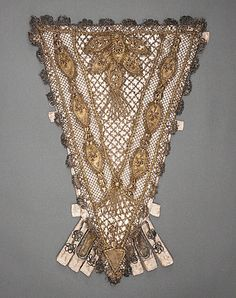 France  Woman's Stomacher, 1700-1750  Costume/clothing principle attire/upper body, Silk satin with metallic-thread lace, silk and metallic-thread plain-weave appliqués, metallic-thread passementerie, and tassels, Length: 15 1/2 in. (39.37 cm)