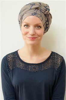 How do you like our NEW, trop chic scarf with its blue bicycle print? We think it has real je ne sais quoi style - see and shop it now among our other new looks in our classic and much-loved long tying turban scarves!