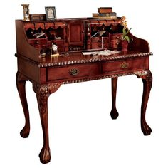 I have this exact desk.  We bought it at auction in Florida for $50.00.  Found this on Wayfair - L'Escritoire Writing Desk in Brown