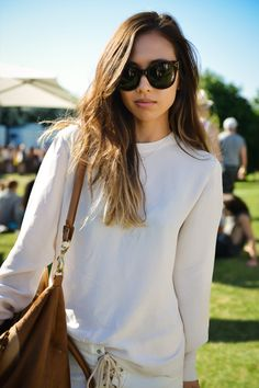 love the glasses and simple blouse.