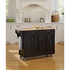 This Mix & Match Create-a-Cart by Home Styles is made of solid wood and will easily store your extra kitchen supplies. The rolling kitchen island cart has four wood framed doors that conceal three storage cabinets with adjustable shelving. Kitchen Island On Wheels, Portable Kitchen, Kitchen Tops Granite, Black Kitchens, Small Kitchen, Kitchen, Kitchen Dining Furniture, Home Styles, Oak Kitchen