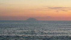Stromboli volcano at sunset