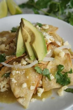 If you like nachos and enchiladas, you'll love this easy chilaquiles recipe, which blends the two. Salsa verde coats the tortilla chips with immense flavor. Easy Chilaquiles Recipe, Chicken Chilaquiles, Mexican Breakfast Recipes, Mexican Dishes, Mexican Food Recipes, Breakfast Ideas, Easy Meals For Two, Easy Food To Make, Green Chile Enchilada Sauce