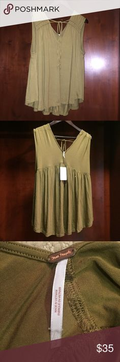 NWT Free People Olive Shirt Brand New with the tags attached. Free people Olive tank shirt. Super cute on, light and flowy. Perfect for summer and headed into fall with a jacket.   Check out my closet for more free people and other namebrand items! Free People Tops Tank Tops