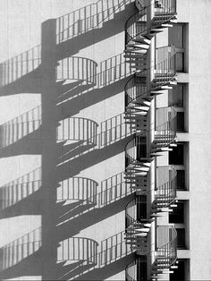 outdoor spiral staircase shadowed on wall