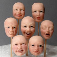 Learn to sculpt polymer clay faces. Group Facesq