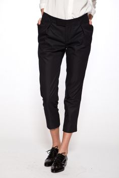tomboy chic outfit: cigarette black trousers, white crisp shirt and black leather brogues