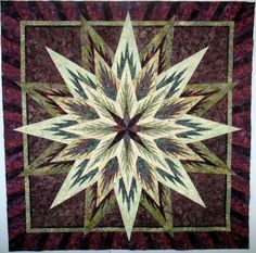 Feathered Peacock Star Wallhanging.  60 inch square.  Using Judy and Brad Niemeyer paper piecing pattern.   12 different batiks. Lovely.  I can't see the quilting.  I'm hoping it did the piecing justice.