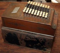 A 1920s Comptometer & Lid.   The Comptometer was the comptometer was the first commercially successful key-driven mechanical calculator.