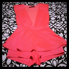 Symphony romper Super sexy neon pink romper! Only worn once during my bachelorette celebration. Absolutely love it but after first wash I noticed pilling. :( The 4th picture has a sample of it. I'm pretty sure flaws won't be noticeable in pictures, might wear it one more time! Lol I added a small clip to hold the front together because of my bust size, can be removed if needed. Size small. Symphony Other