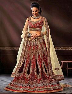 Sketch your life with colors and prints with this innovative maroon net bridal lehenga choli.