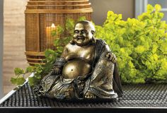 This smiling Buddha statue brings dramatic style to your room by way of his metallic fleck finish. Sitting with beads in his hand and a warm smile, he will be a delightful addition to any decor. x x high. Polyresin and felt bottom. Buddha Statue Home, Buddha Home Decor, Buddha Statues, Outdoor Statues, Garden Statues, Gautama Buddha, The Monks, Buddhism, The Ordinary
