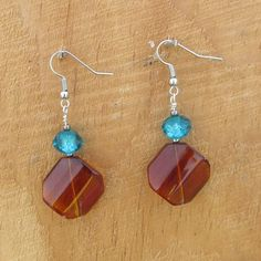 Adorable spring time earrings. Check out this item in my Etsy shop https://www.etsy.com/listing/226443533/brown-glass-diamond-bead-with-turquoise