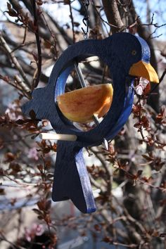 This beautiful blue hand painted bird will brighten any yard. This handcrafted bird style feeder was designed to allow your feathered friends to