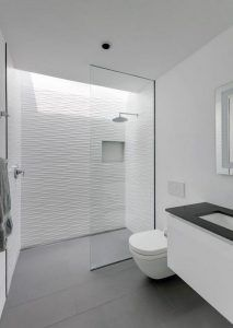 grey flooring Grey floor tiles have been paired with textured white tiles to create a contemporary bathroom, while a skylight located above the shower adds a touch of natural light to the space. Bathroom Layout, Modern Bathroom Design, Bathroom Interior Design, Bathroom Ideas, Bathroom Showers, Shower Rooms, Showers For Small Bathrooms, Small Walk In Showers, Roll In Showers