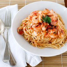 Shrimp Fra Diavolo with Vermicelli  2 tablespoons cooking oil 1 onion, chopped 2 cloves garlic, minced 1 1/2 cups canned crushed tomatoes in thick puree (one 16-ounce can) 1/4 teaspoon dried red-pepper flakes 1/4 cup water 1/4 cup chopped fresh parsley 3/4 teaspoon salt 1 pound medium shrimp, shelled 3/4 pound vermicelli