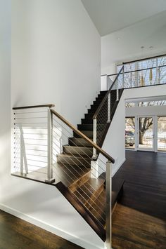 Cable Railing Systems: What's Cable Rail? - All About Cable Railing for Stairs Cable railing systems offer an alternative to traditional stairway railing by using cable rail wire tension for stability, rather than newels and balusters. Indoor Stair Railing, Cable Stair Railing, Interior Stair Railing, Modern Stair Railing, Stair Railing Design, Outdoor Stairs, Staircase Railings, Modern Stairs, Railing Ideas