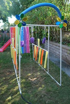 "This is an awesome DIY project for the summer - older kids can help build it and just about everyone will love taking a stroll through the ""kid wash""!  #summeractivitiesforkids #DIY #outdoors"