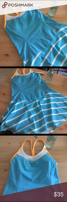 New Balance Tournament Dress NWT New Balance Tournament Dress. Tennis dress I bought never wore because it was too short for my liking (I'm also 6' so a lot is short on me 😅) Otherwise I would have loved this for tennis or just out looking sporty. Has built in shelf bra (no padding). Moisture wicking fabric. Make me an offer on this one New Balance Dresses