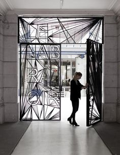 LabGate. Mathieu Lehanneur. Amazing black intricate bespoke custom screen gate. Possibly laser cut steel. Linear design with graphic text element.