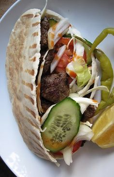 Kebaps- the most classic and authentic Turkish dish.  The meat (usually lamb, beef or veal) is cooked on a vertical split and then sliced down and served in a flatbread or pita bread.