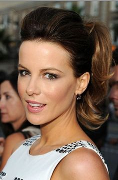 "Hairstyles for round faces . . . Professionals have specific skills in creating slimming effects with hairstyles. Here are some their ""go to"" haircuts for round face shapes. Kate Beckinsale ponytail with volume"
