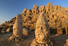 Nemrut Dagi - is a 7,001 ft high mountain in southeastern Turkey, notable for the summit where a number of large statues are erected around what is assumed to be a royal tomb from the 1st century BCE.