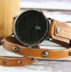 Studded Women's Leather Wrap Watch in distressed brown color. The leather band features gunmetal rivets and a black minimalist Cuckoo Nest Art Studio watch face.