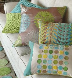Color at play: Circles of many hues, some striped, some color-blocked, in a crisp grid on a neutral ground, are fun yet work in a wide range of settings.