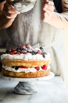 This light and fluffy mixed Berry and Cream Sponge Cake is layered with jam…