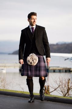 If you're looking for something extremely versatile, the black tweed jacket and waistcoat design is for you. Strikingly formal and appropriate for any any wedding or special occasion