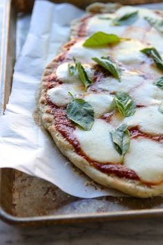Grilled Herb Pizza with Smoked Mozzarella and Basil. So delicious. #dinnerrecipes #laurenslatest.com