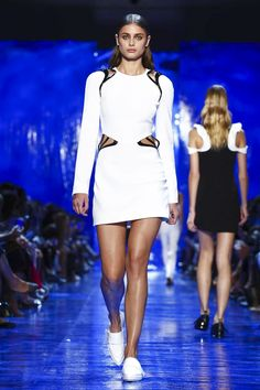 A deep blue ocean is where Mugler's rocker mermaids swim. Because David Koma imagined a sexy, rock and roll Atlantis, populated by statuesque figures like Gigi Hadid or Karlie Kloss. For Sping/...