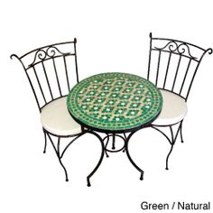 The table of this beautiful, 3-piece bistro set arrives with a 27-inch ceramic top detailed with a bright tile mosaic of the Moroccan Zellige technique. Black iron with curved accents makes up the base of this waterproof dining set.