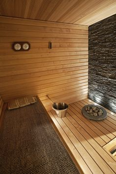 Sauna ideas with stone wall. Nice use of indirect lighting, but I think we need windows too.