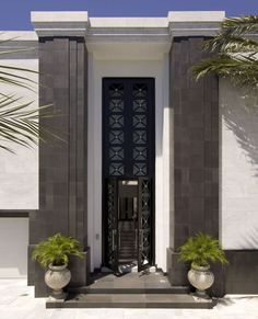Architects Bruce Brockhouse and Al Naranjo created a marble façade to conjure a museum-like aesthetic. Imported black stone pilasters frame the 24-foot-high Deco 'X' entry doors, establishing a sense of grandeur. #LuxeTurns10